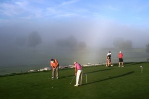 Practice green in the fog