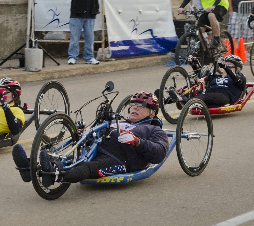 Dennis Clark rides his handcycle in the Covenant Health Marathon