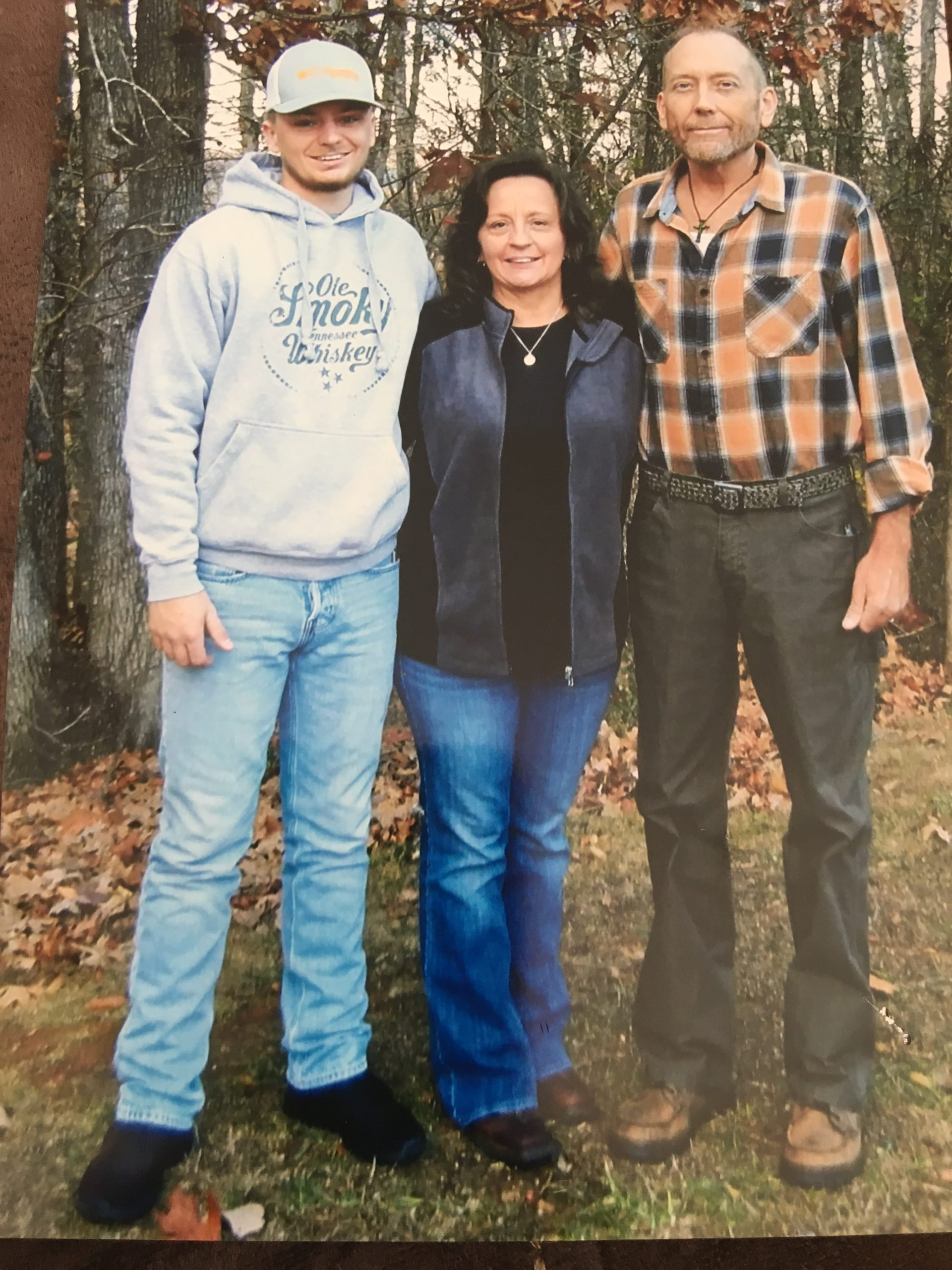 Angelia Johnson with her son and late husband.